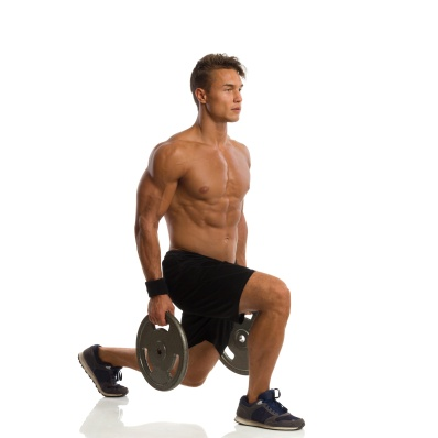 Man Doing Split Squat With Weights. Side View